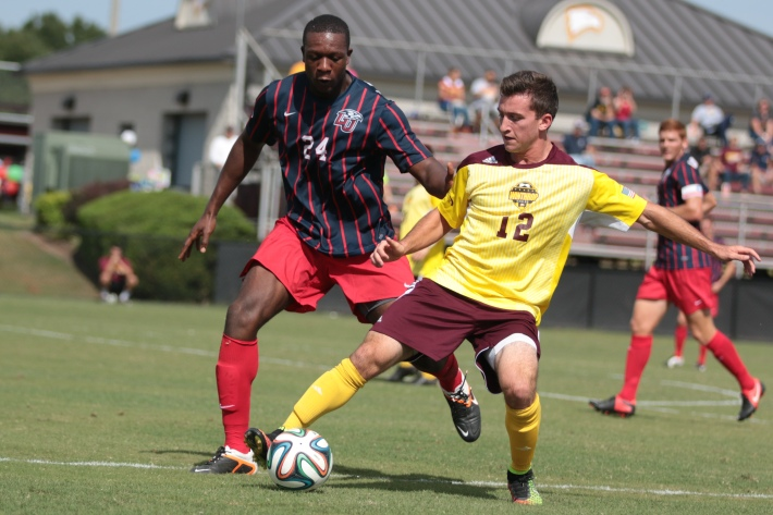 Sam Schmidt, right, and Glodi Konga, left, fight for control of the ball.
