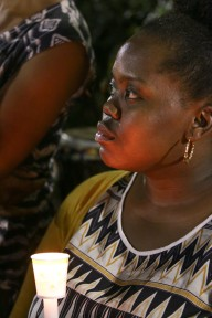 An anonymous women holds a candle at a vigil for Walter Scott.